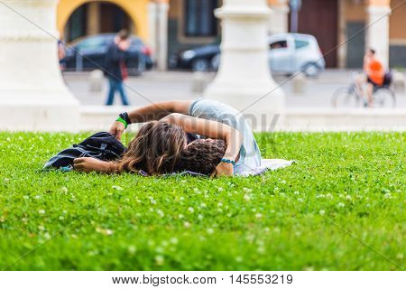 PADUA ITALY - August 5 2016: Piazza of Prato della Valle Padova Italy.Young people relaxing on the grass