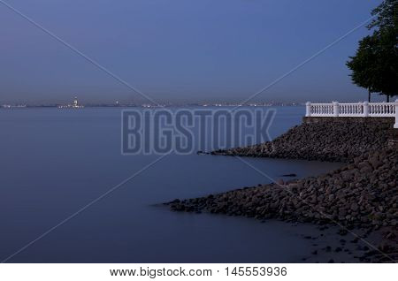 Type on Seaport of St. Petersburg from Peterhof with breakwaters and a balustrade.