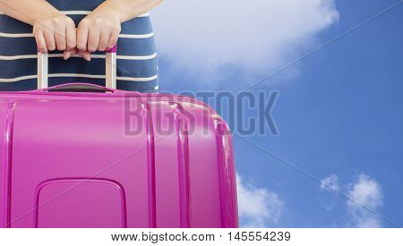 Single woman hold pink suitcase on her hand with blue sky and white cloud background