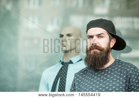 Bearded Man In Cap Near Showcase