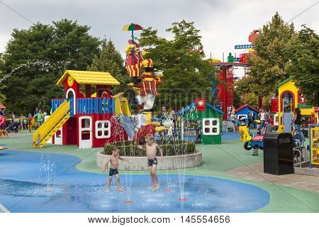 GUNZBURG GERMANY - AUG 18 2016: Children playing in a fountain at the Lego themed park Legoland Deutschland in Guenzburg Baden Wurtemberg Germany