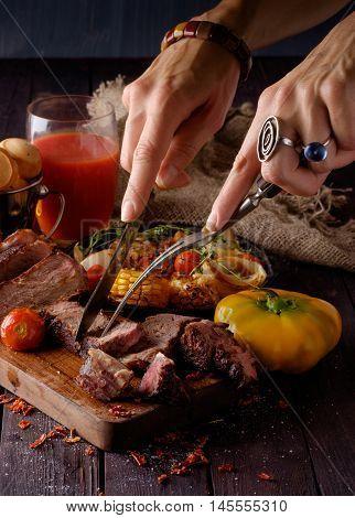 Grilled Steak Sliced On A Cutting Board.