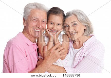 Happy grandparents with granddaughter on white background