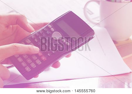 savings finances economy and home concept - close up of man with calculator counting making notes in the crisis at home soft focus.