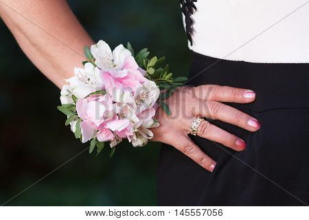 Wrist corsage of hydrangea and alstroemeria flowers on a hand