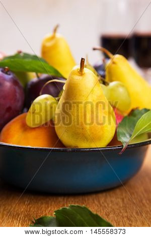 autumn apples,blue plum,speach and grape with red wine in dish