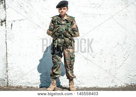 Little Girl Soldier In Camouflage