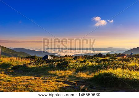 Picturesque sunrise morning in mountains camping above clouds Carpathians Ukraine