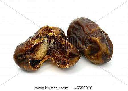 Dry date palm fruit on a white background