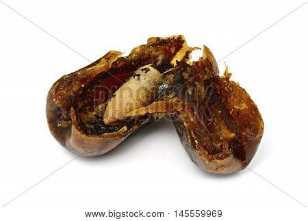 Inside dry date palm fruit on a white background