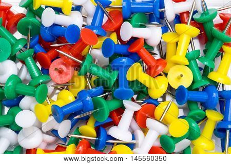 Pile of colorful thumbtack in closeup for attachment.