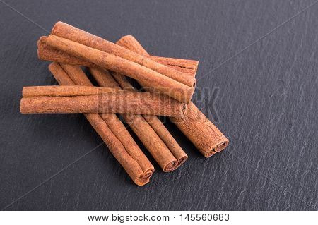 Cinnamon Sticks On Slate Tile With Faded Effect