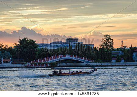 Bangkok scenic view on river Chao Phraya at sunset