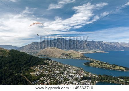 Queenstown, New Zealand - March 2016: Tandem Paragliding Over Lake Wakatipu In Queenstown, New Zeala