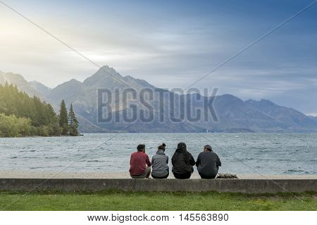 Queenstown New Zealand - March 2016: Tourists enjoying spectacular view of Lake Wakatipu at Queenstown lakefront New Zealand