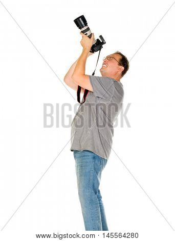 Middle age man taking pictures by dslr camera with tele lens isolated on white