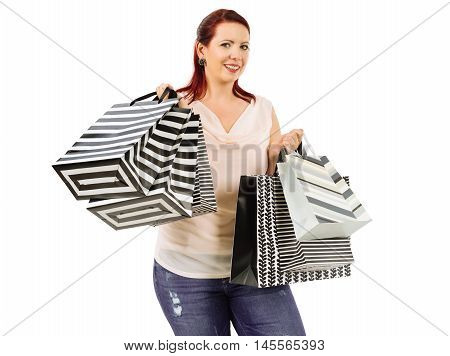 Photo of a happy woman holding six shopping bags.