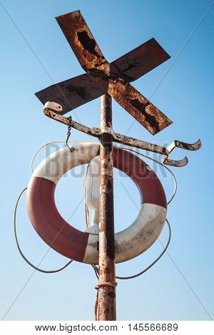 Old Rusted Cross Shaped Navigation Sign