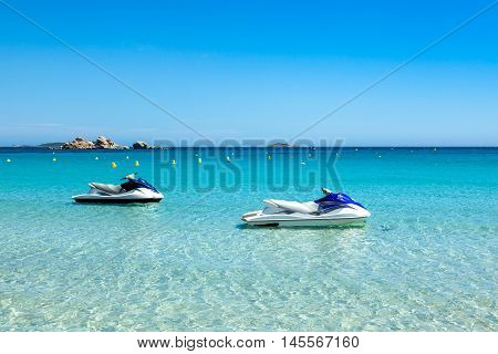 Jet Ski Mooring In The Turquoise Water Of  Rondinara Beach In Corsica Island In France