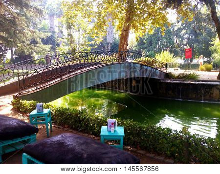 View of the bridge over the lake of crystal palace gardens in Oporto