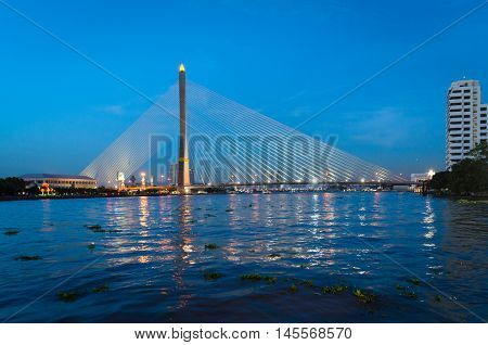 Bangkok Rama VIII Bridge and river Chao Phraya at blue hour