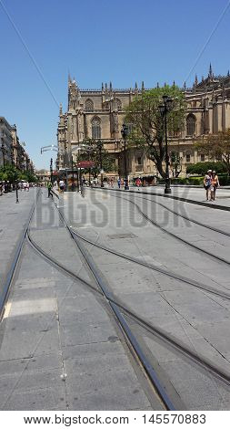Seville, Spain - June 22, 2016: Tramway. St. Mary's Cathedral in Seville. People on the street