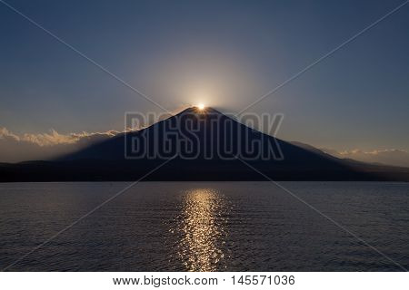 Fuji diamond Sunset on Top of Mountain Fuji and refection at Lake Yamanakako in autumn season