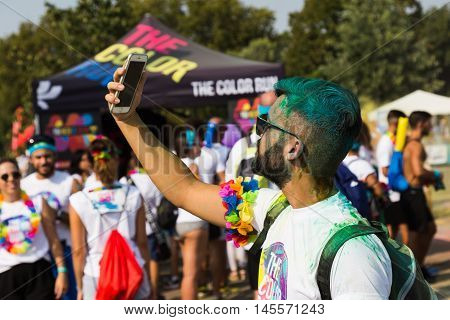 MILAN ITALY - SEPTEMBER 3: Thousands of people take part in the Color Run event the funniest and most colorful urban running ever on SEPTEMBER 3 2016 in Milan.