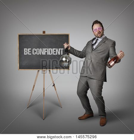 Be confident text on  blackboard with drunk businessman