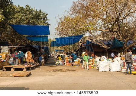 DELHI INDIA - 19TH MARCH 2016: The outside of markets in Central Delhi during the day. Lots of people can be seen.
