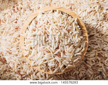 Rice Rice berry or rice berries in wooden bowl on brown rice