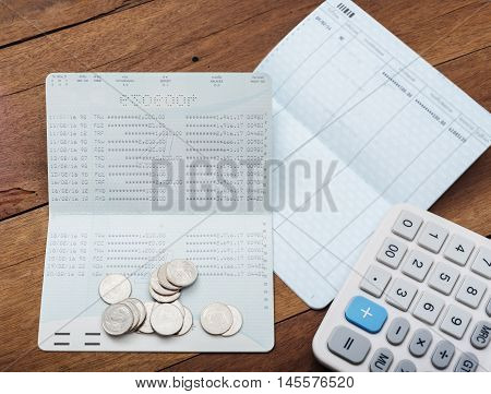 Save money concept, Stack of coins with account bank or bank book