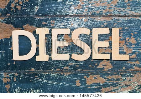 Word diesel written with wooden letters on rustic surface