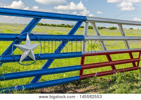Texas flag gate in Ennis countryside in spring