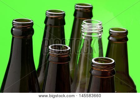 Close up of glass bottles. A close up of several brown glass bottles and one clear glass bottle.