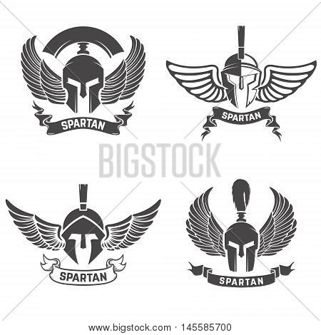 Set of the spartan helmets with wings. Design elements for logo label emblem sign brand mark. Vector illustration.