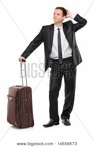 Full Length Portrait Of A Worried Businessman With A Suitcase