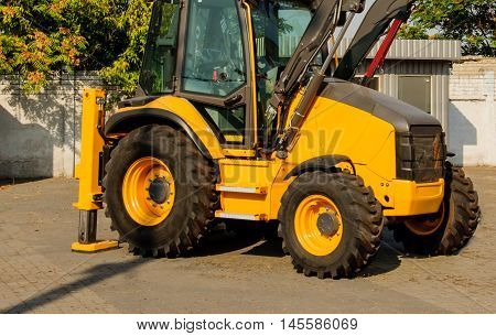 Construction machinery. Yellow excavator parked. Construction machinery