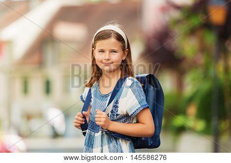 Pretty little 9 year old girl walking back to school