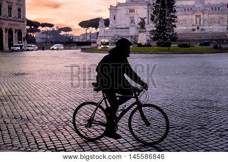 Italy, Rome, Altare della Patria Vittoriano - Cyclist having his morning ride.