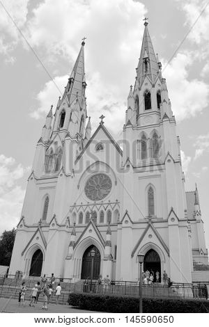 SAVANNAH GEORGIA USA 06 26 2016: Cathedral of saint John the Batist, French Gothic-style architecture towering over the historic district, the Cathedral of St. John the Baptist dates back to the 1870s