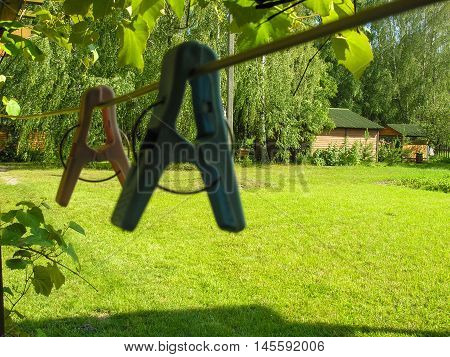 Clothespins and rope for drying clothes on the lawn in a country house