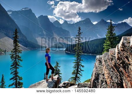 Woman at Moraine Lake in Rocky Mountains. Banff National Park Alberta Canada.