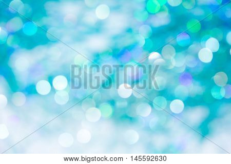 Lights on blue background. holiday bokeh. Abstract. Christmas background Festive abstract background with bokeh defocused lights and stars