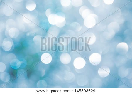 Lights on blue background. holiday bokeh. Abstract. Christmas background. Festive abstract background with bokeh defocused lights stars