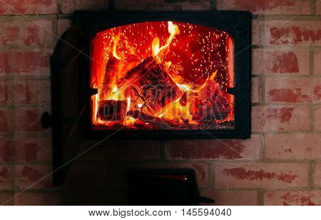 Heating concept. Fire from the furnace. Firewood in the oven