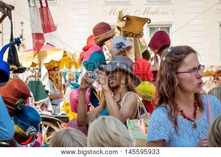 TALLINN, ESTONIA - JULY 8, 2006: Tourists on the Medieval market In Old City in Tallinn.