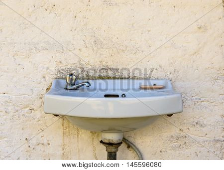 Outdoor sink and dirty wall