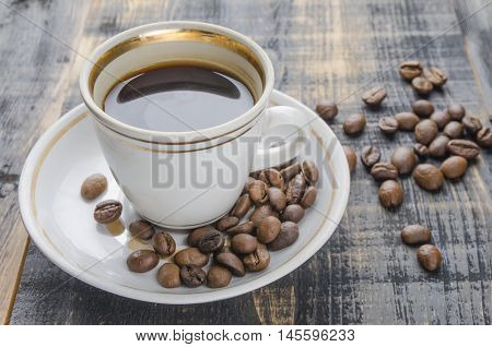 cup of scalded coffee on a table in studio