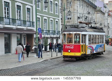 LISBON PORTUGAL - DECEMBER 27: Tram number 12 stops at Rossia sqaure in Lisbon on December 27 2013. Lisbon is a capital and the largest city of Portugal.